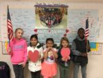 Summit Elementary Students in front of Veterans Day banner