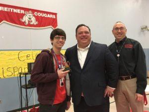 Teacher John Parciak receives Teacher of the Month award from Jason Rehg