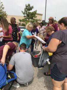 CMS Staff Handing out School supplies