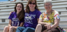 Two women and girl in Kahok Stadium stands