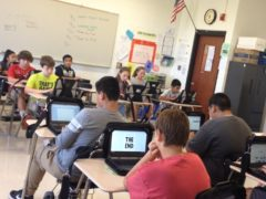 Collinsville Middle School students in classroom using Chromebook computers