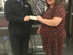 Beth Bancroft presents $1000 check to CHS band director Robert Wright