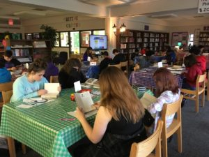 Students reading during book tasting
