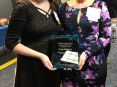 Former CHS student Courtney Kutey with teacher Cynthia Bednara