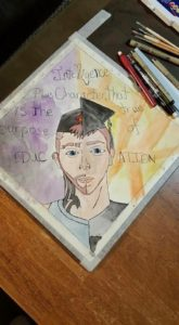 Artwork of Split Face with Caption: Intelligence Plus Character is the True Purpose of Education