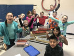Summit students posing with new music instruments