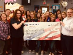 PreK staff accepts $300 check from Perez Insurance
