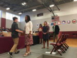 CMS Principal Dr. Kim Jackson congratulates a student