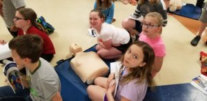 DIS students with CPR dummy