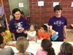 High School students help younger students with experiment