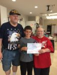 Student Elliott Schusky with James and Kathy Conn representing the VFW