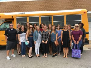 New staff in front of school bus Group 1