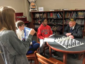 Students Interviewing Veteran in CMS Library