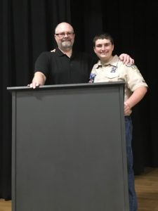 Brad and Hunter Snow with new podium at Webster Elementary